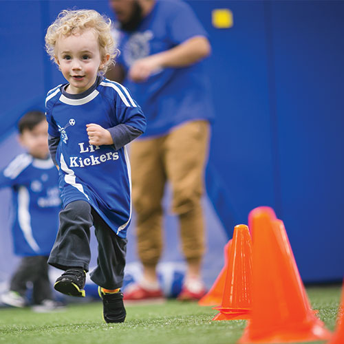 Kid Running in Soccer Practice