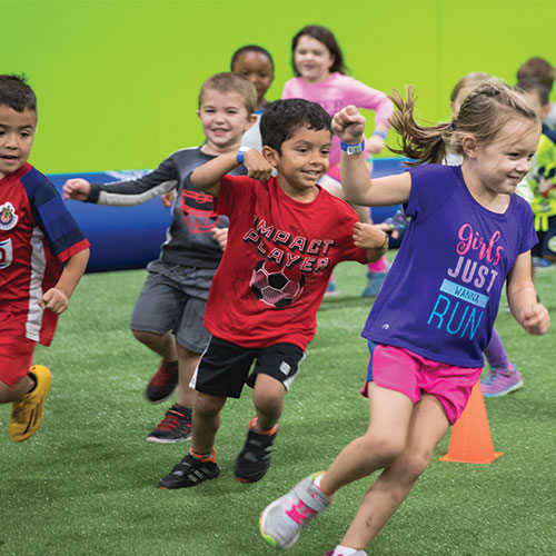 Kids running at Soccer Open House